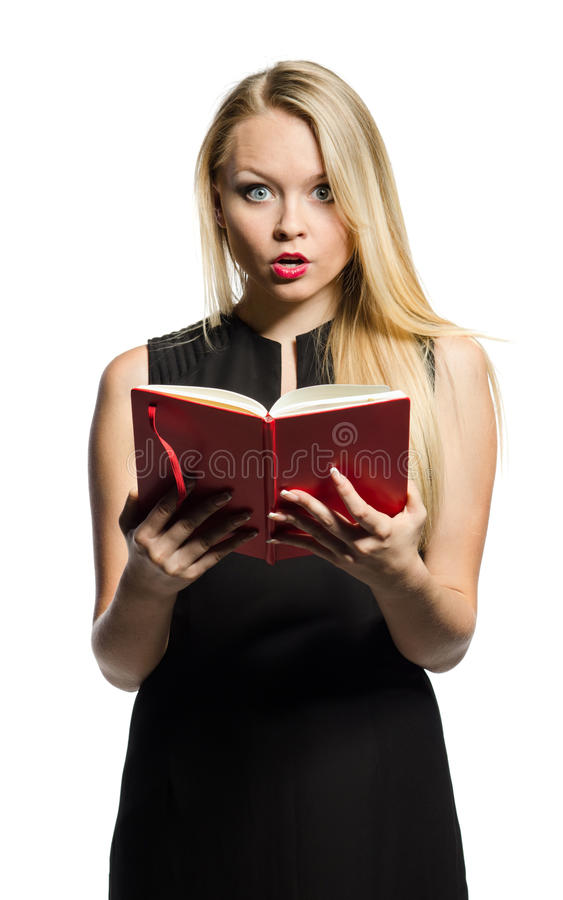 Young Blond  Wonders With Notebook Royalty Free Stock Images