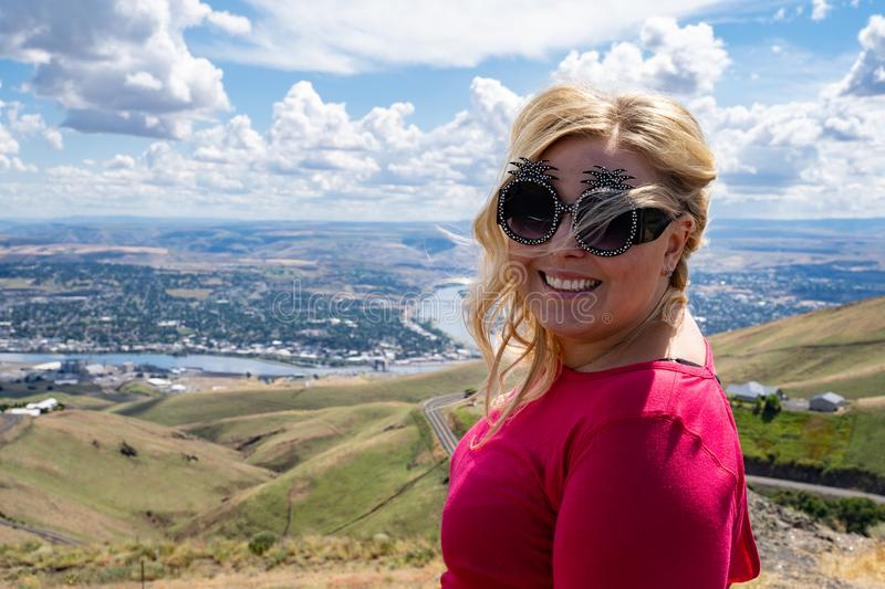 Young blonde adult woman poses at the Lewiston Idaho Hill Overlook into the Clearwater Valley, wearing novelty pineapple stock photos