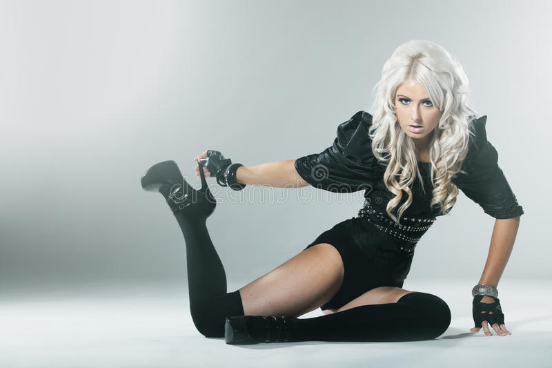 Young blonde in attractive high fashion black clothes royalty free stock image