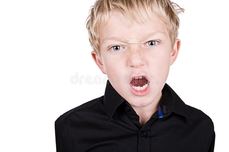 Young Blonde Boy Shoting Into The Camera Royalty Free Stock Images