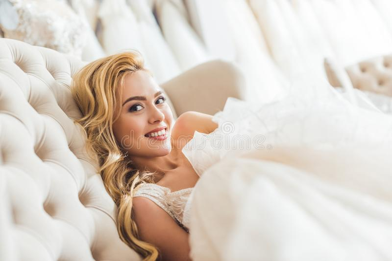 Young blonde bride wearing tulle dress in wedding royalty free stock photography