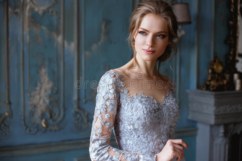 Young blonde bride woman in a light blue wedding dress royalty free stock photography