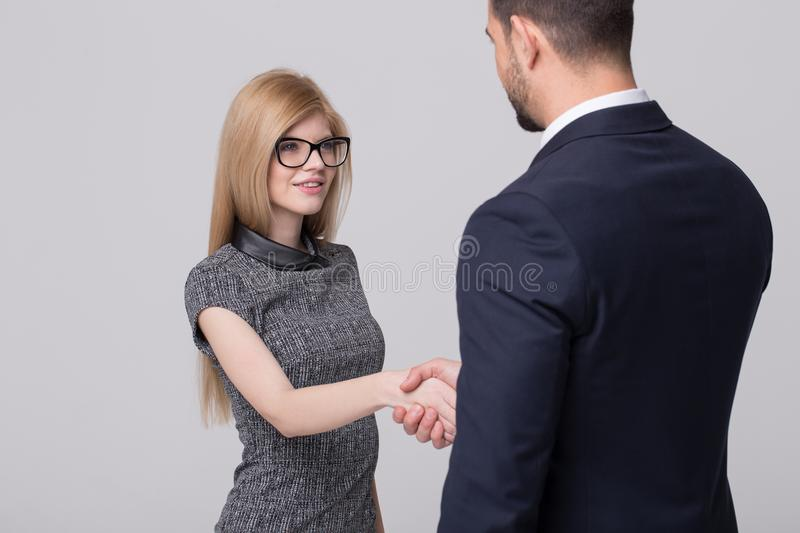 Young blonde businesswoman handshake with professional businessman portrait royalty free stock image