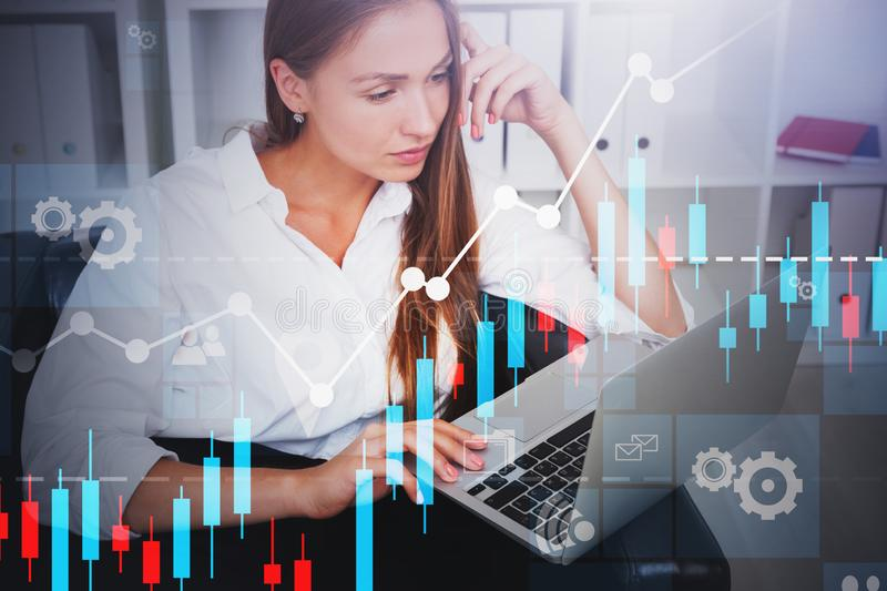 Blonde businesswoman with laptop, graphs royalty free stock images