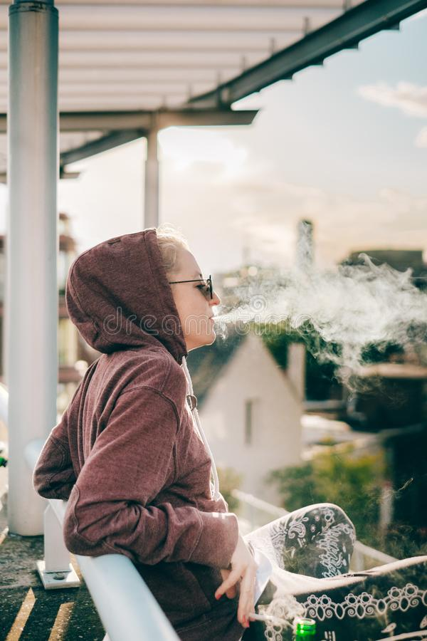 Smoking and chilling at the roof stock photography