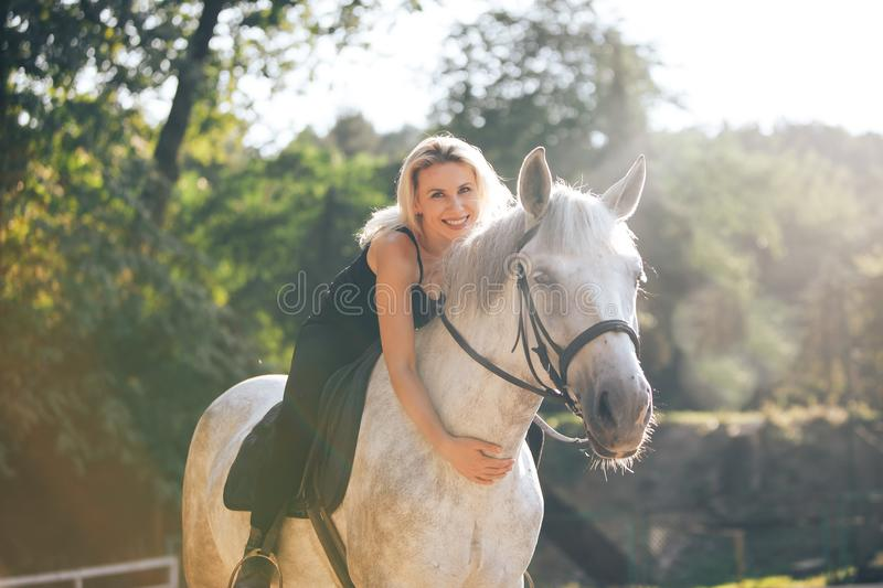 Young Girl Riding Her Horse royalty free stock image