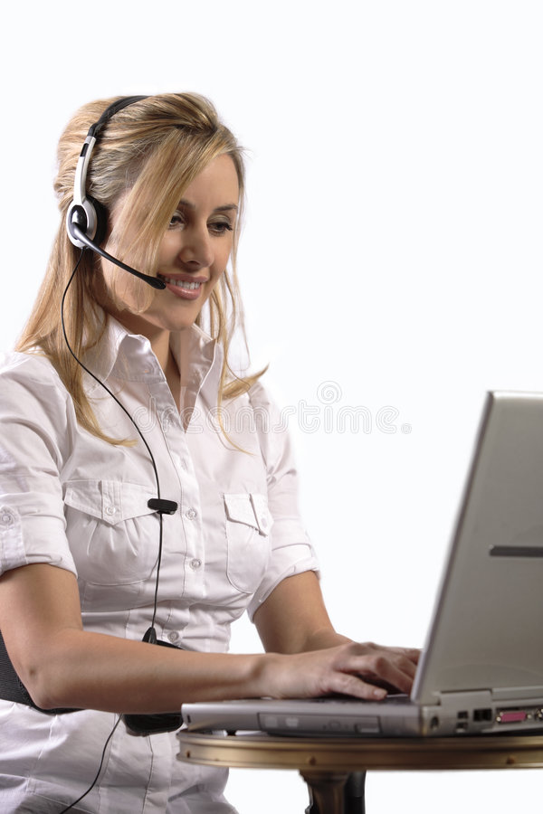 Free Young Blonde Girl Working On Laptop With Headset Royalty Free Stock Images - 4962219
