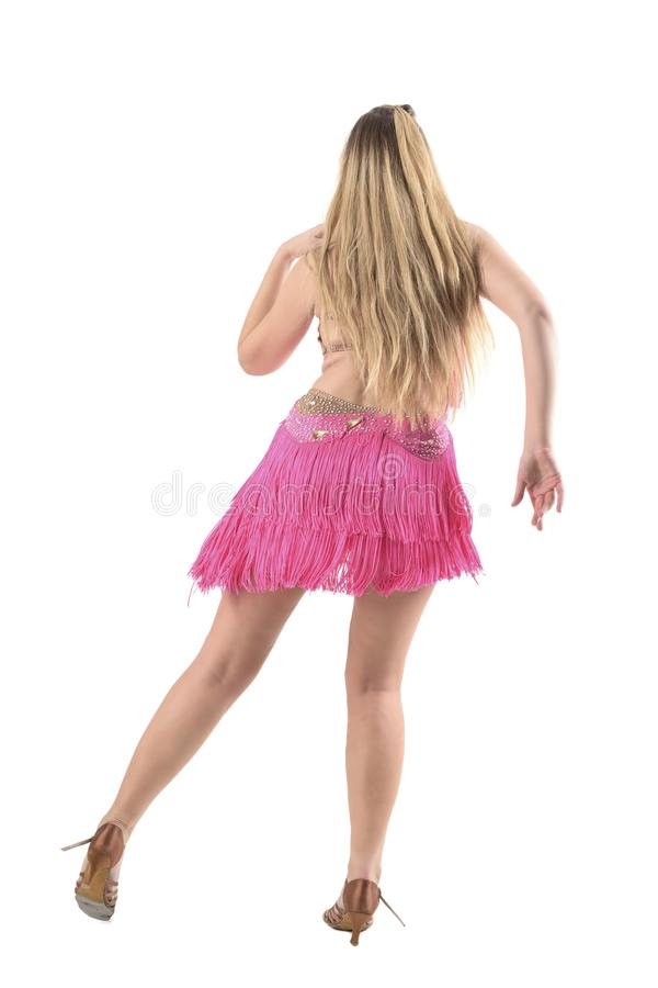 Young blonde hispanic latino dancer rear view with side step posture. stock image