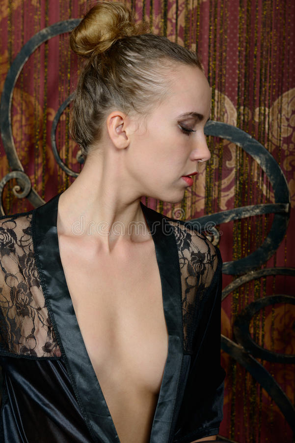 Free Young Blonde In A Black Negligee Royalty Free Stock Images - 63613179