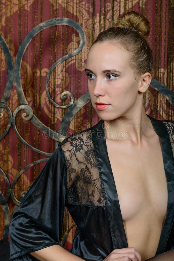 Free Young Blonde In A Black Negligee Stock Photography - 63613222