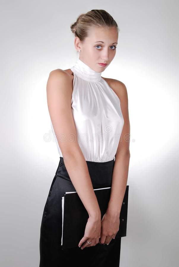 Download Young Blonde Shy Businesswoman Holding  Folder Stock Image - Image: 11406765