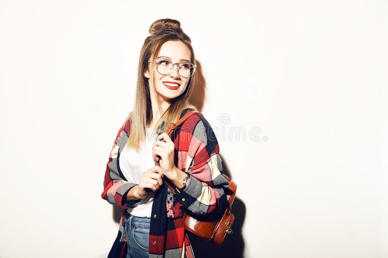 Young blonde student girl looking at camera. Education, training. Cool hipster student woman. Fashion pretty young woman stock photography