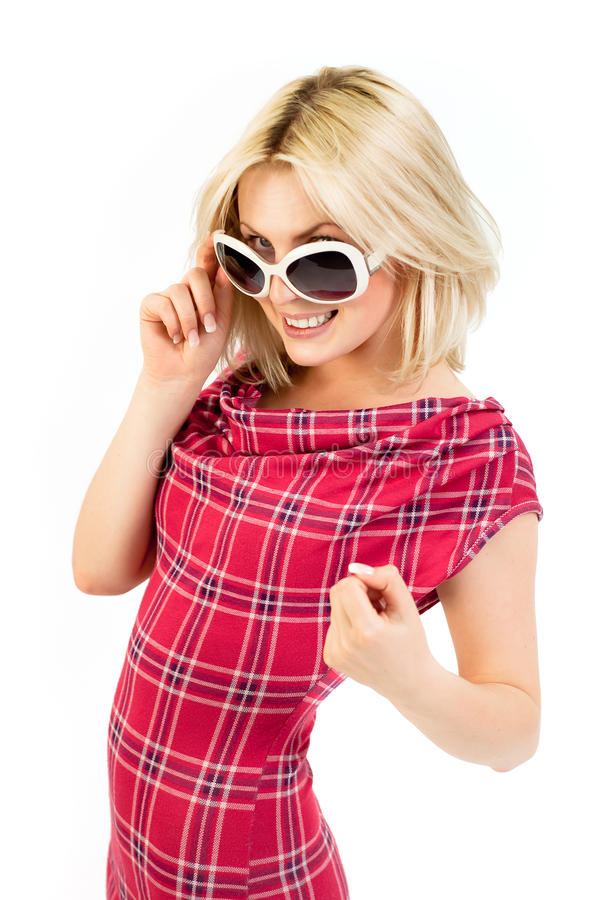 Young blonde in tartan dress stock photo