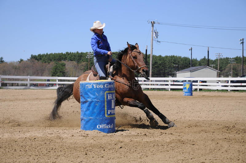 Young blonde woman barrel racing royalty free stock photos