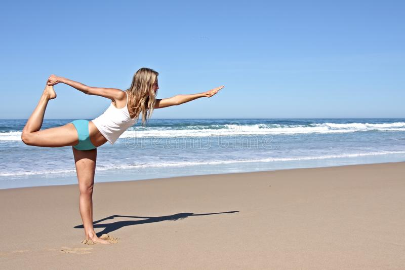 Young blonde woman doing exercises