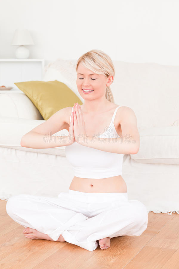 Download Young Blonde Woman Doing Yoga In The Living Room Stock Photo - Image: 19636714