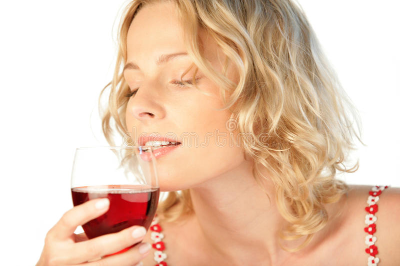Young blonde woman drinking glass of red wine