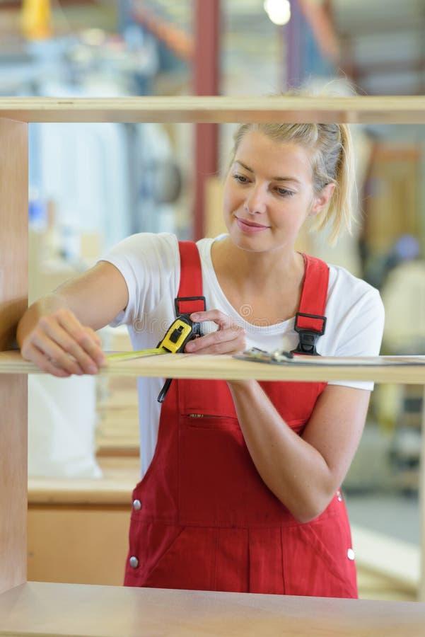 Young blonde woman enjoying work in art studio. Woman stock photos