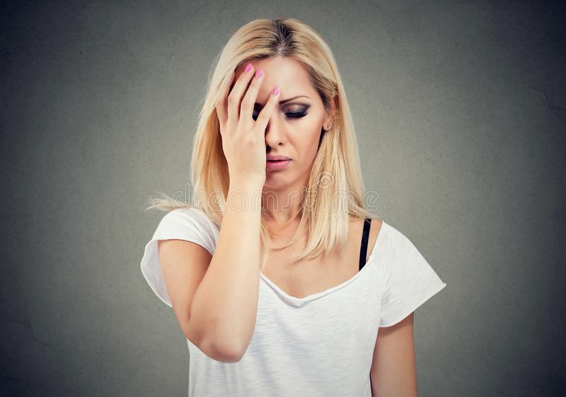 Young blonde woman feeling stressed and hopeless royalty free stock image
