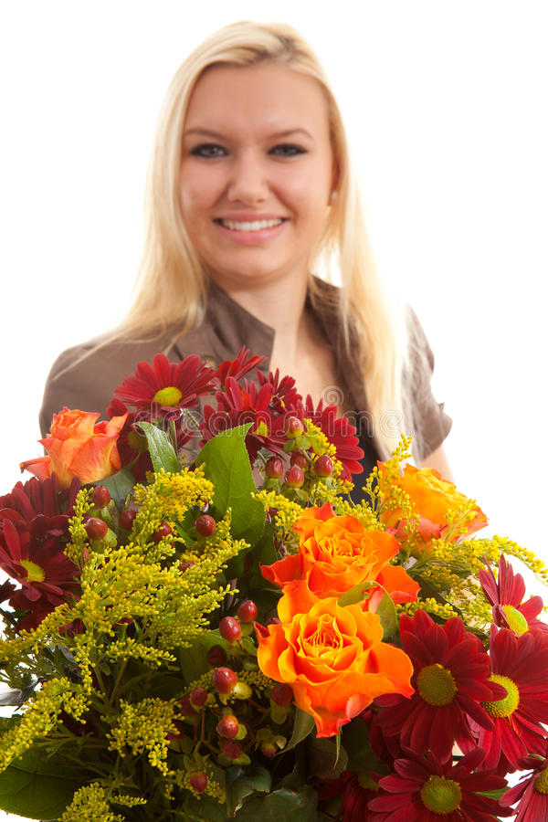 Young blonde woman gives bouquet of flowers