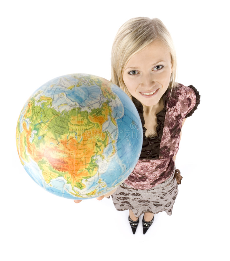 Young blonde woman with globe royalty free stock photo