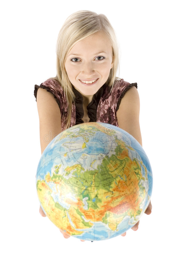 Young blonde woman with globe royalty free stock photos