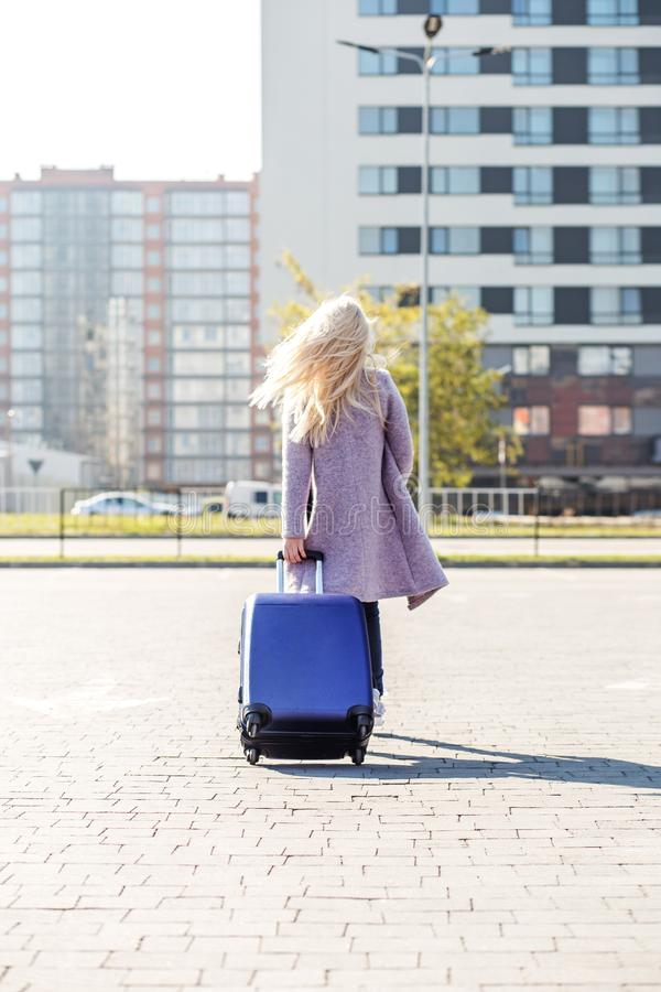 Young blonde woman going on vacation. The concept of travel, wor stock images
