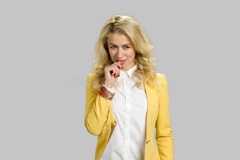 Young blonde woman having an idea. royalty free stock photography