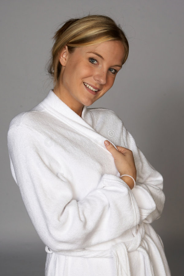 Young Blonde Woman Holding Bathrobe Closed royalty free stock images