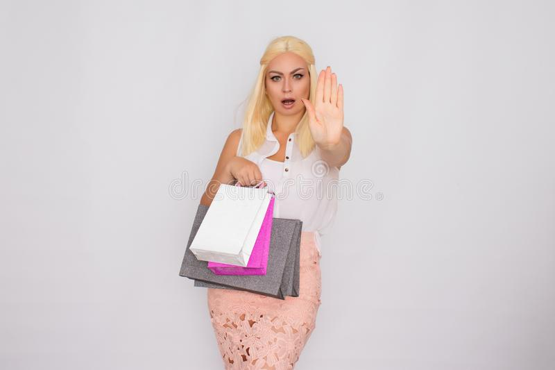 Young blonde woman holding shopping bags in hands stock photo