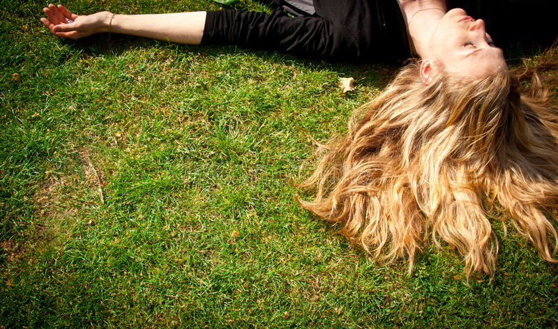 Download Young Blonde Woman Lying On The Grass. Stock Photography - Image: 19497322