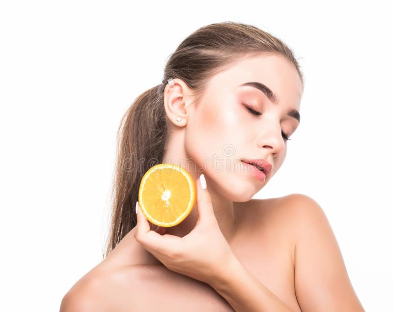 Young woman with citrus fructs in her hands isolated on white background. Skin care, cosmetology concept. stock photos