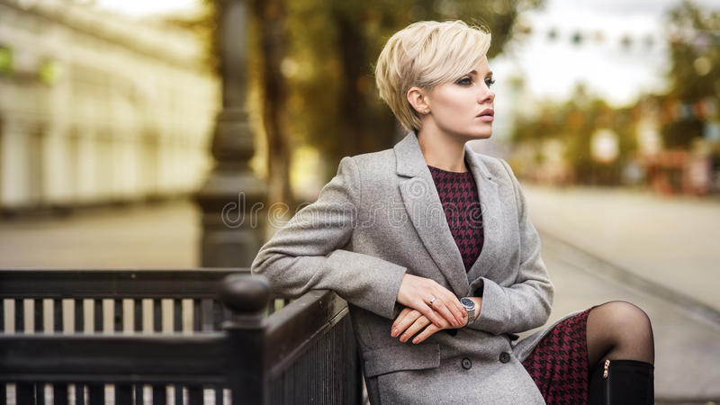 Young blonde woman portrait in autumn color royalty free stock image