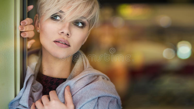 Young blonde woman portrait in autumn color stock images
