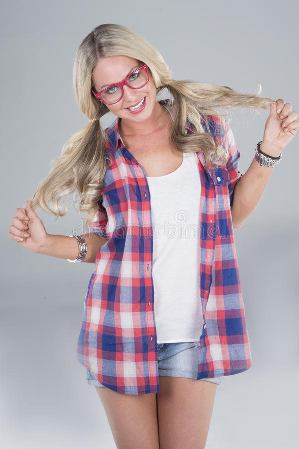 Young blonde woman posing royalty free stock photo