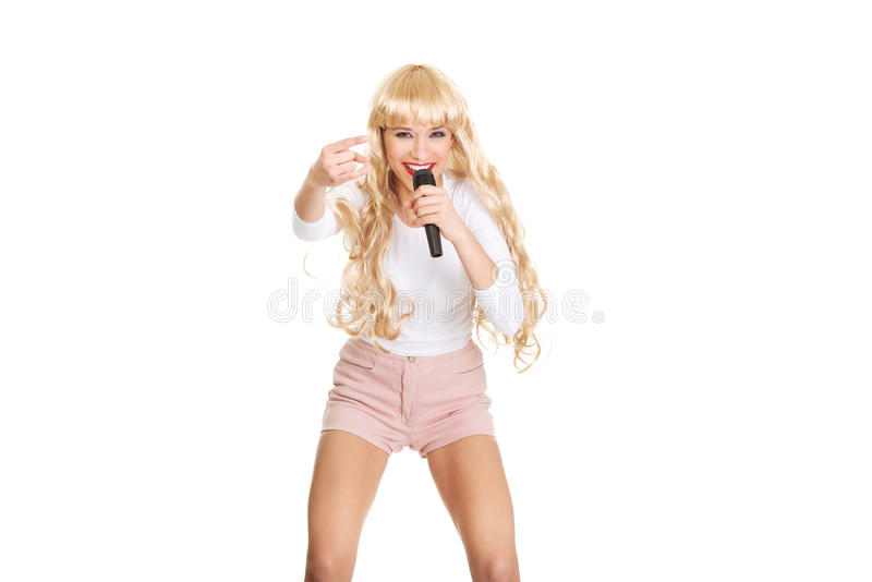 Young blonde woman singer. Beautiful young blonde woman singing royalty free stock image