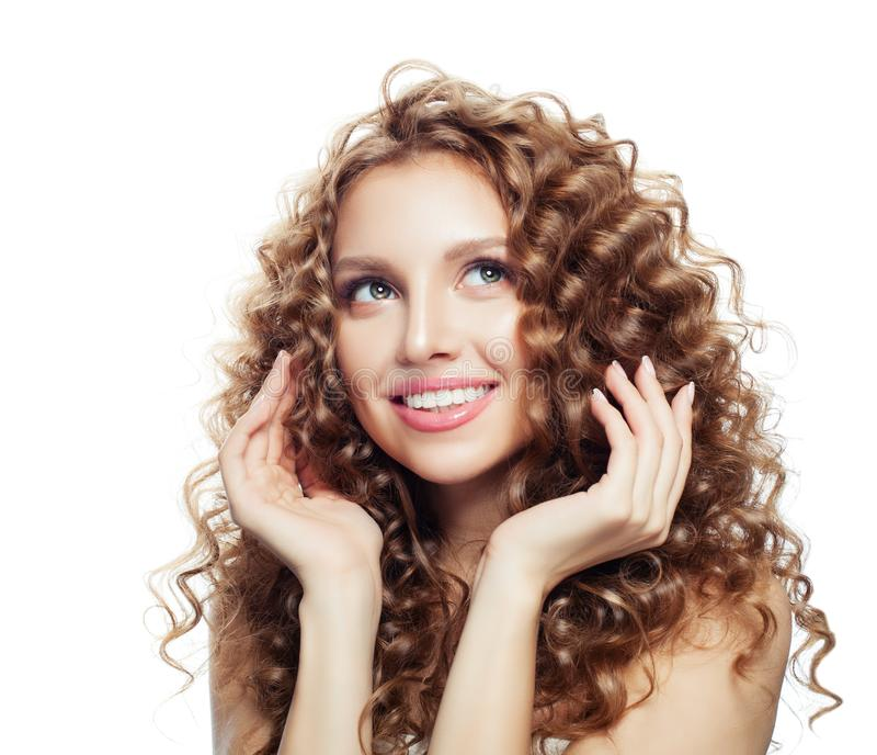 Young blonde woman smiling and touching her hair her hand royalty free stock photography