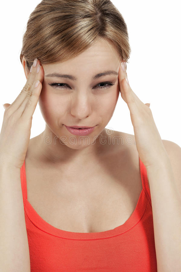 Young blonde woman suffering headache stock images