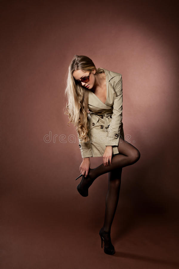 Young Blonde Woman In Topcoat. Stock Images