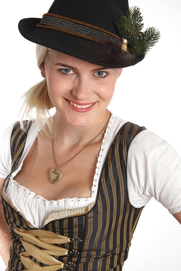 Young blonde woman in traditional costume royalty free stock image