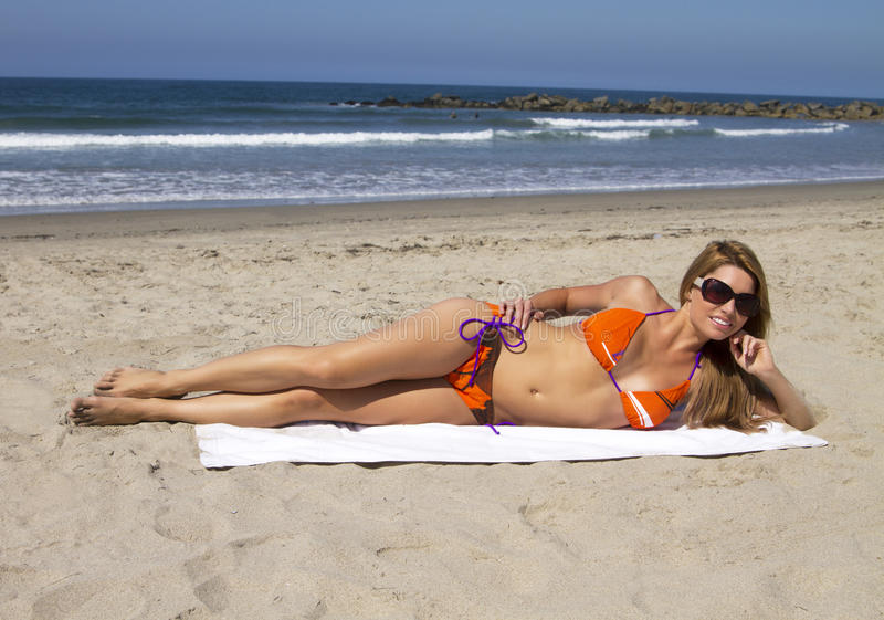 Young blonde woman vacationing at the beach stock image