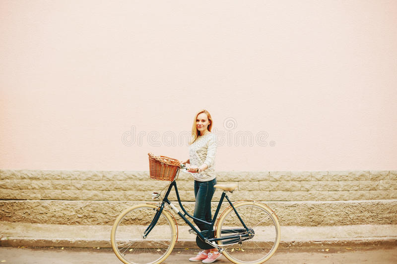 Young blonde woman on a vintage bicycle stock photo