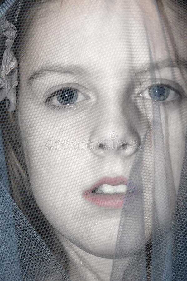 Young blue eyed veiled girl stock photography