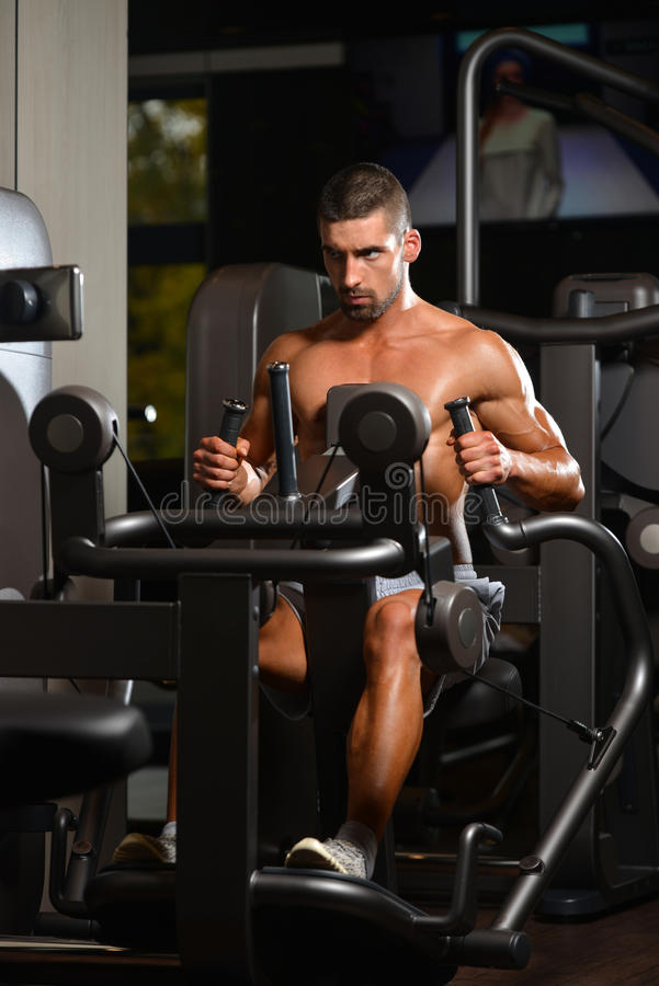 Young Bodybuilder Exercising Back On Machine royalty free stock photo