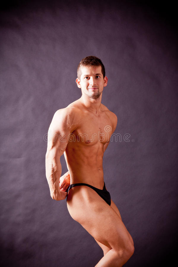 Download Young bodybuilder posing stock image. Image of competition - 30669079