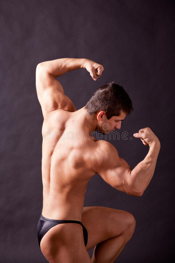 Download Young bodybuilder posing stock photo. Image of body, flex - 30669104