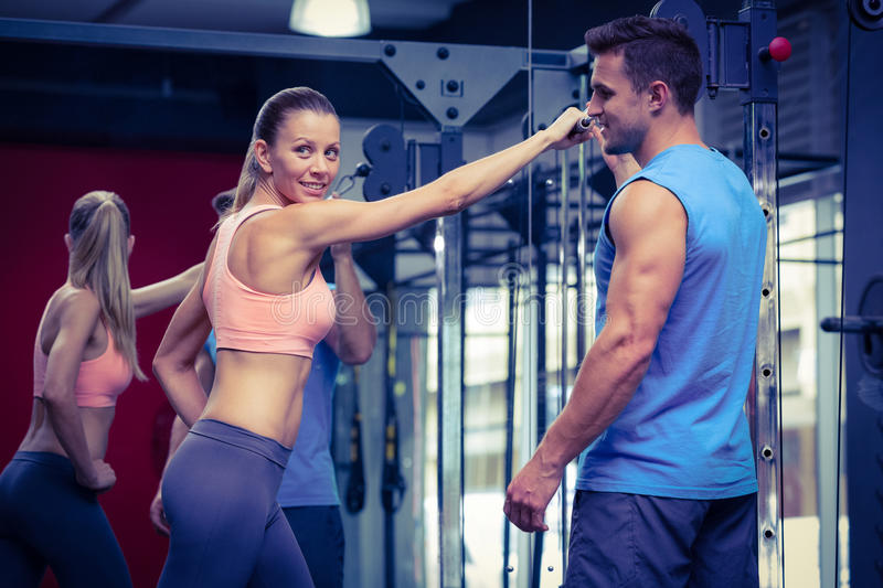 Young Bodybuilder training a young woman stock photo
