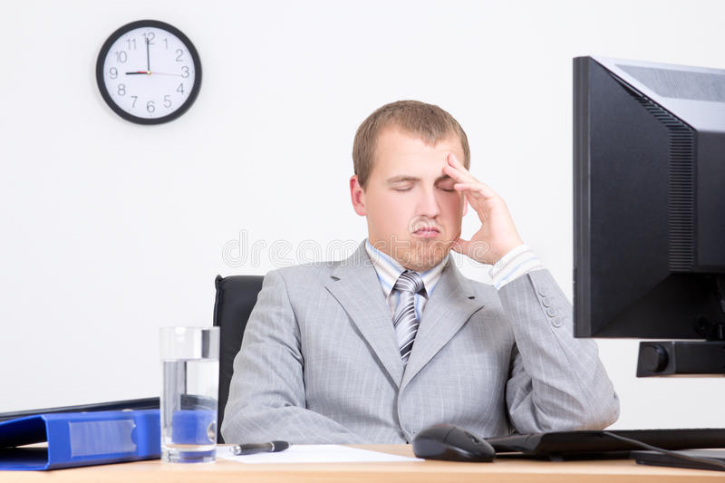 Young bored businessman sleeping in office. Young bored businessman sleeping in his office royalty free stock photography