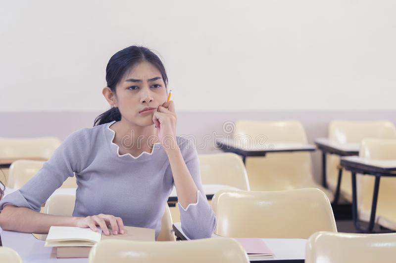 Asian young girl student lazy and bored in class and tried for learn study. royalty free stock photos
