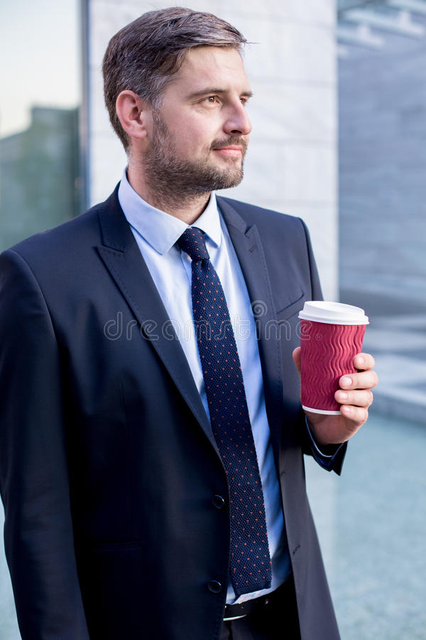 Young boss drinking takeaway coffee stock images